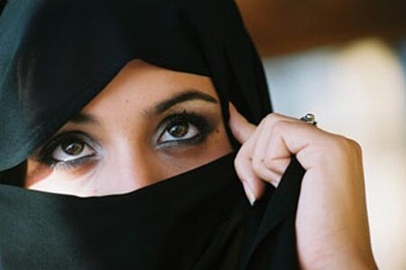 An Islamic woman wearing an old-fashioned Hijab (covering for body).
